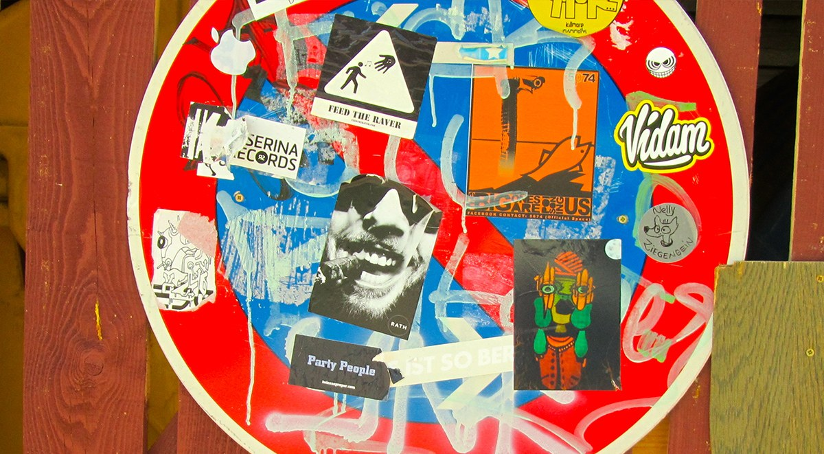 Stickers on a traffic sign, Berlin sticker  graffiti  artist home new  video  nyc free  vinyl  shipping just 2014  obey link  screen urban